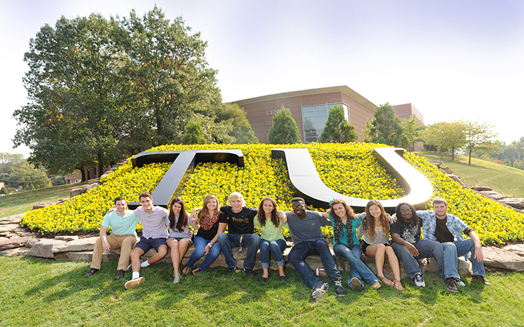 Students in front of TU sign