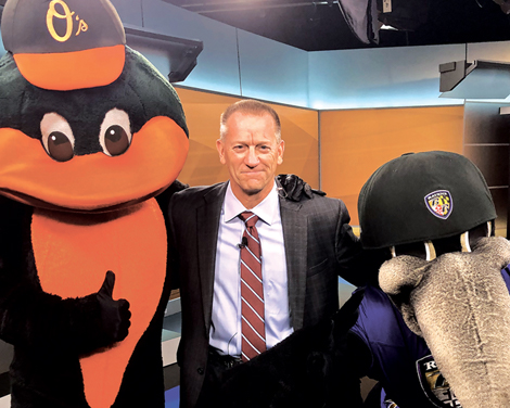 Keith Mills with the Orioles and Ravens mascots
