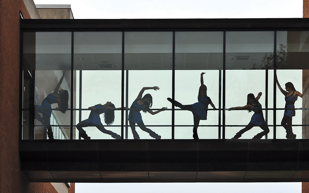 dancers through a window