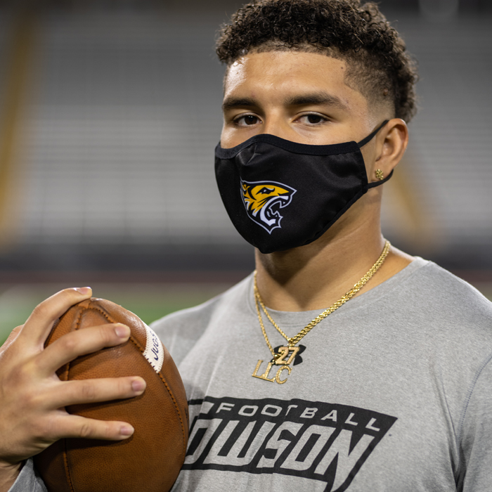 S.J. Brown wearing a mask outside