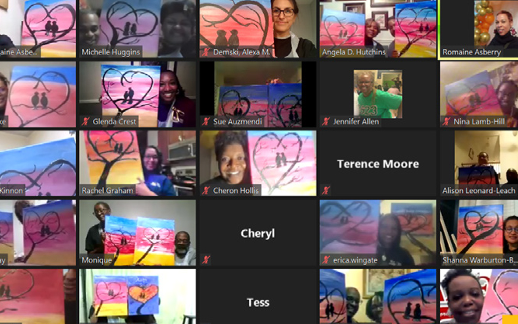 screenshot of a zoom meeting's participants, holding artwork