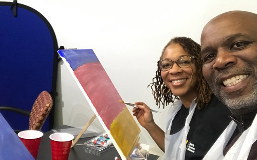 a man and a woman painting