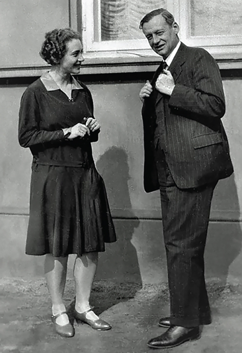 White woman and man standing together in a black and white photo