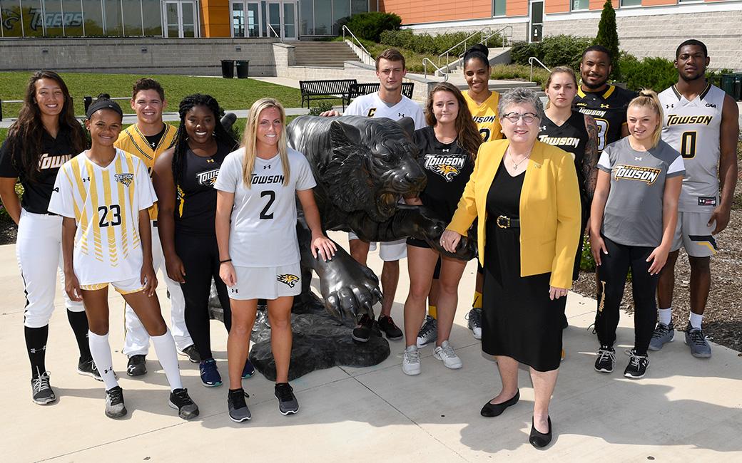 Towson Unviersity Student-Athletes pose with President Kim Schatzel