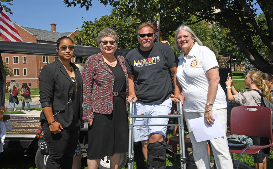 From left: Benz Armstrong, TU President Kim Schatzel, Chuck Ritz and Tracy Miller. Ritz, co-founder of The Hope and Peace Foundation, brought the 9/11 Rolling Thunder Memorial to Newell Field for a special ceremony.
