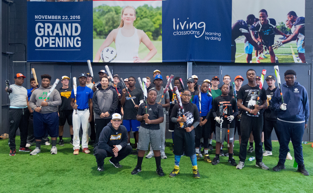 Members of the Towson University baseball team pose with students who participate in the Baltimore Urban Baseball Association (BUBA) camps. TU's student-athletes volunteered at the camps this fall.