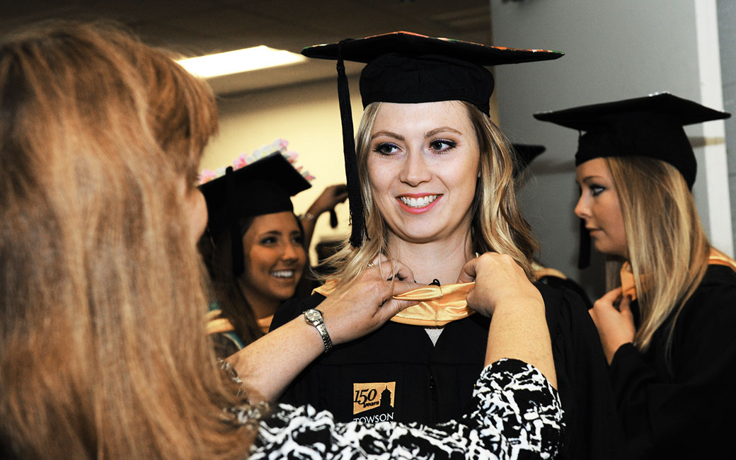 Alumni and staff volunteers are the hidden helping hand for graduates before, during and after the ceremony.