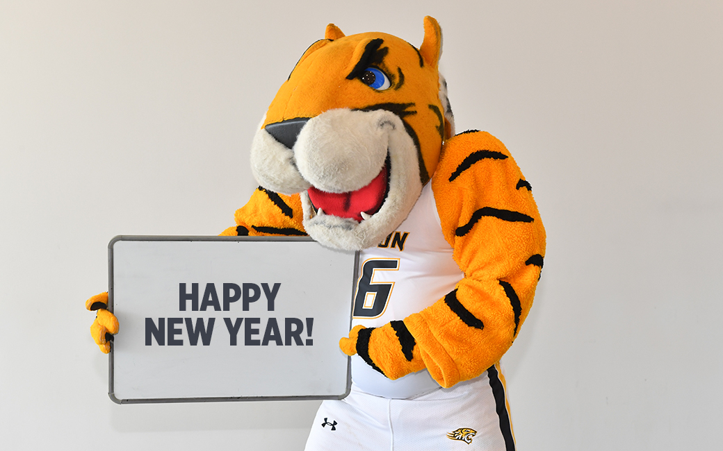 Doc holding a Happy New Year sign