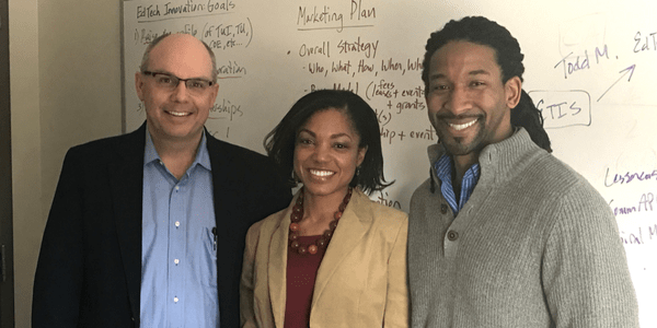 Towson University's Director of Entrepreneurship Frank Bonsal (left), poses with Nicole Tucker-Smith and Khalid Smith, founders of the company Lessoncast.