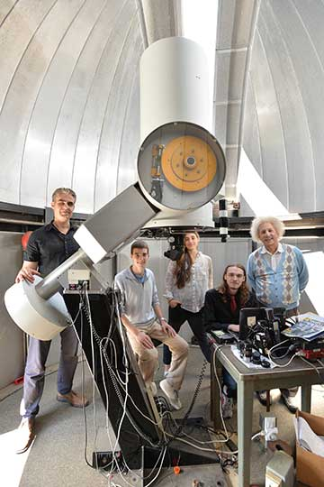 Physics professor, student and Einstein in the observatory