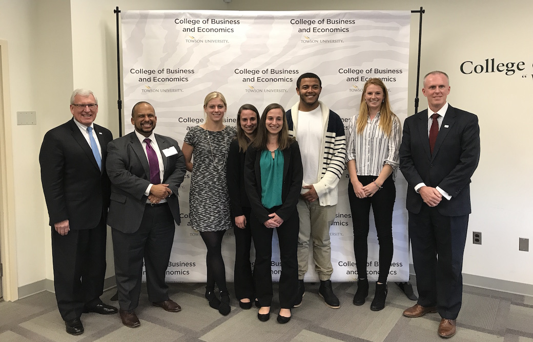 The winning team (center) of Madison Bove, Meredith and Meghan Price, Amos Campbell and Renate Van Oorschodt with members of SECU's judges' panel.