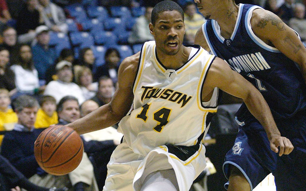 Gary Neal drives the basketball while playing for Towson.