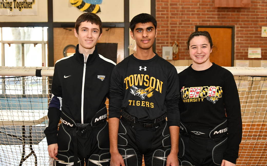 Members of the Towson University goalball club sport team—Tim Utzig, Muhammad Waheed and Rachael Talbert—pose for a photo before the their first game in February 2017.