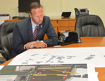 Greg Slater looking at construction maps
