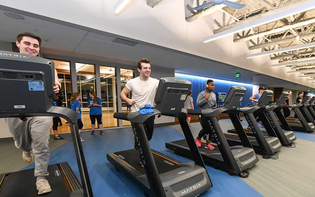 Three men on treadmills