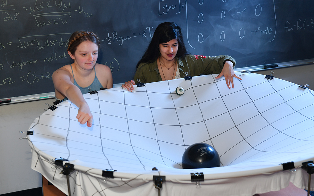 physics students Rachael Huxford and Hamna Ali in classroom