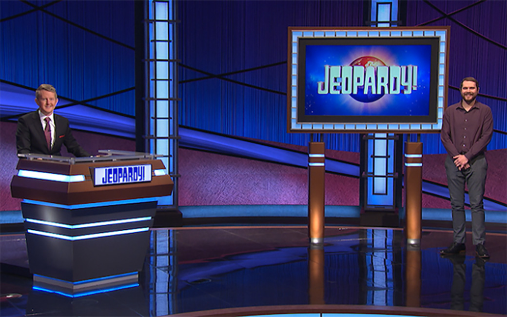 Game show floor of Jeopardy! with host Ken Jennings and Henry Michaels