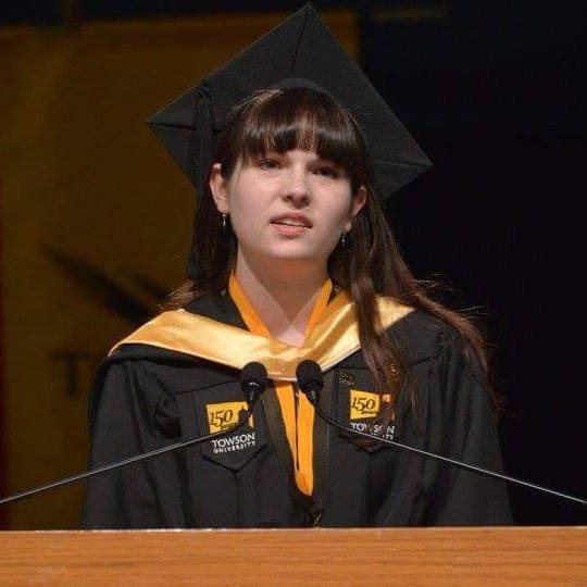 Lily McFeeters at the podium speaking at Commencement 2016