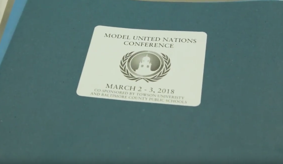 Video of Folder front from Model UN table