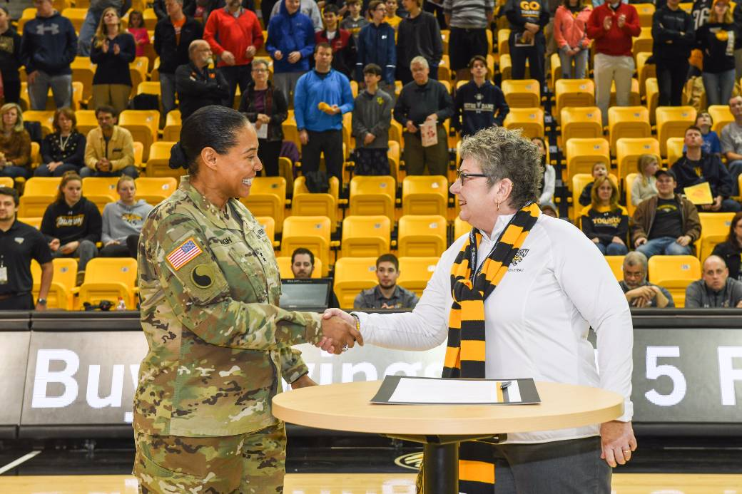 Towson University President Kim Schatzel shakes hands with Maryland Adjutant General Linda Singh after signing a Memorandum of Understanding between Towson University and the Maryland National Guard. The signing took place before Towson Men's Basketball game on Saturday, January 27.