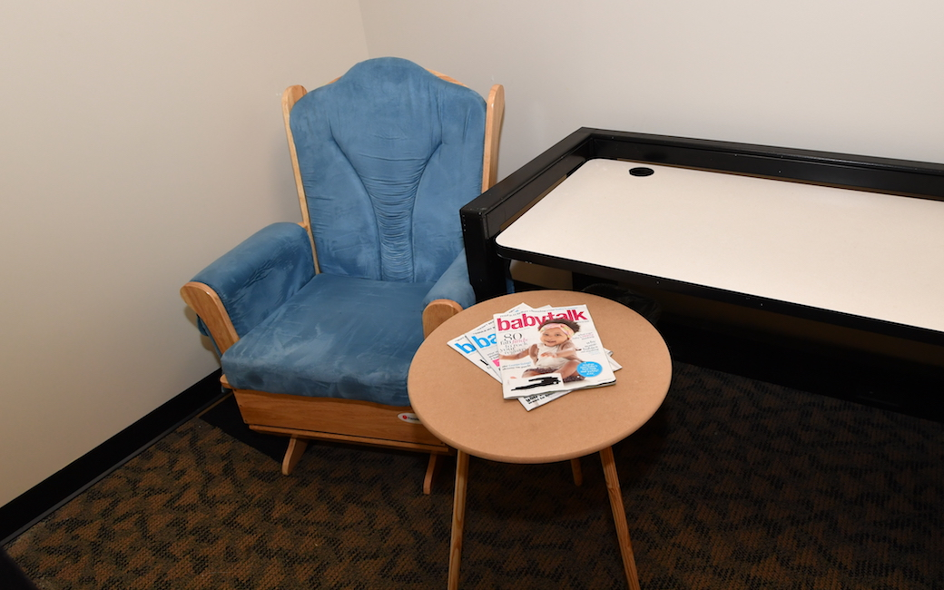 The nursing mothers' room in the Administration Building has a comfortable chair, outlets, a table and easy access to the restrooms.