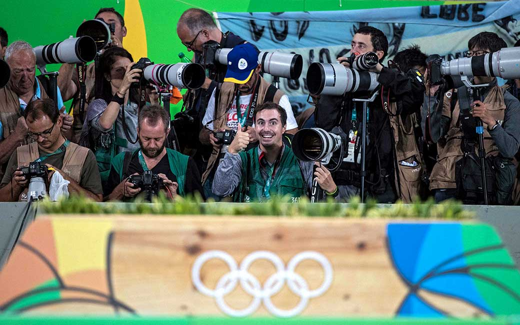 Patrick Smith '09 among the photographers in Rio