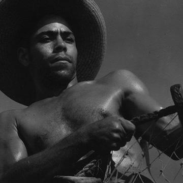 Black and white film still of laborer