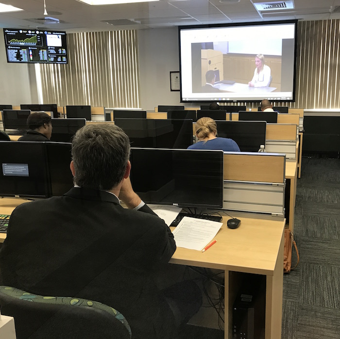 Sales professionals judged students' pitches via a closed-circuit video feed.