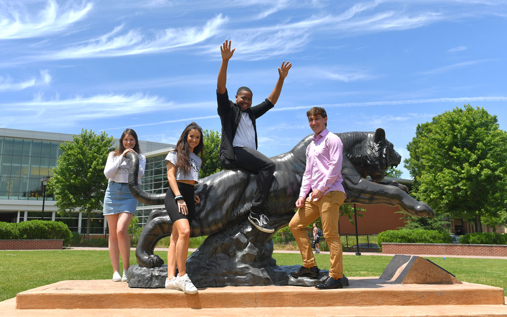 Students posing on Tiger Statue