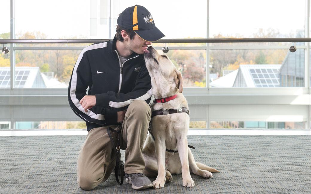 Tim Utzig and service dog Alisa