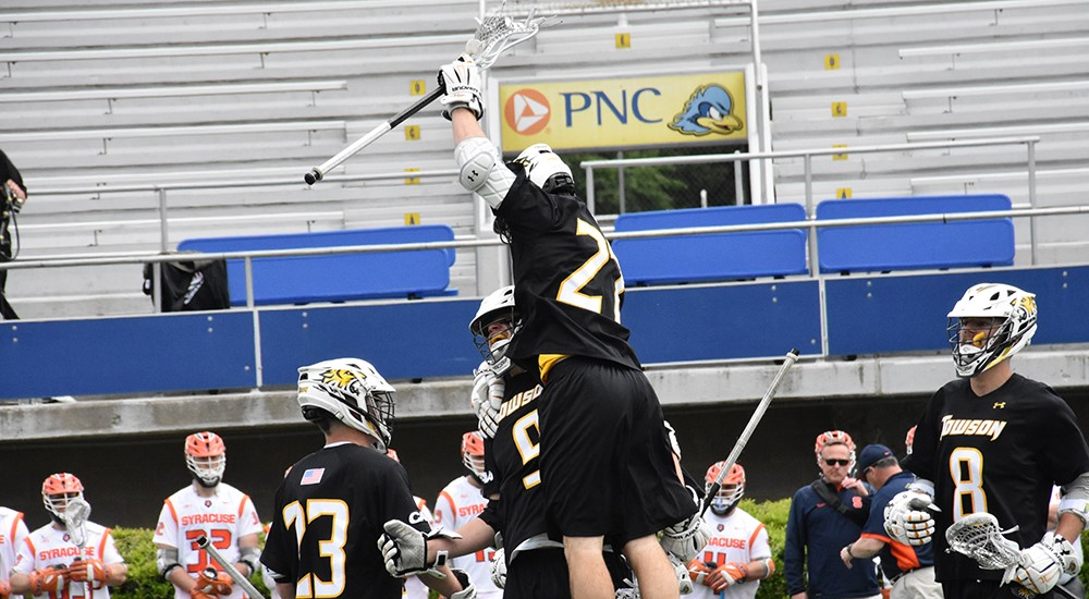 The Towson University men's lacrosse team celebrates after scoring a goal in Sunday's NCAA Tournament Quarterfinal game against Syracuse. The Tigers defeated the Orange, 10-7, and will move on to the NCAA Tournament Semifinals.