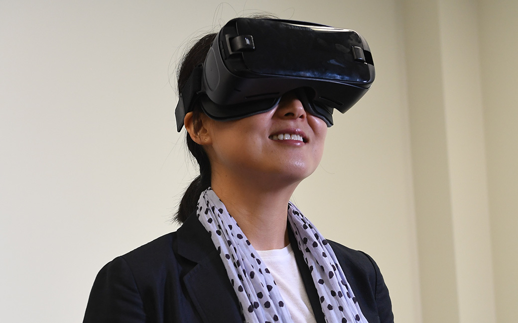 Faculty with virtual reality headset