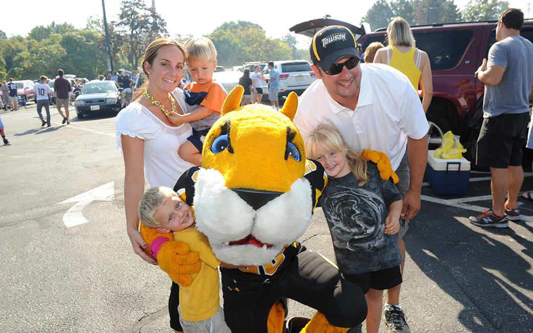 family smiling with doc the tiger
