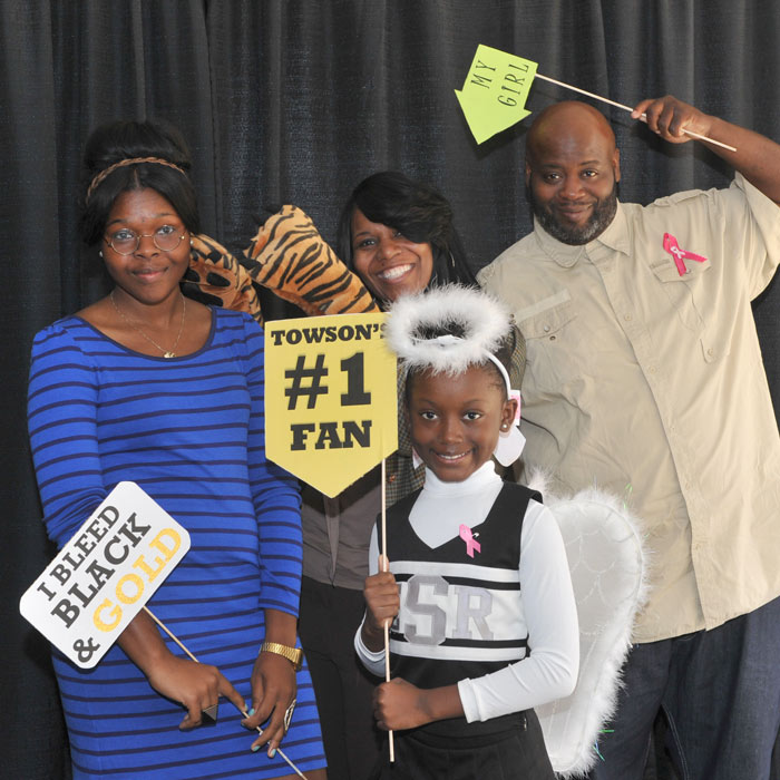 family posing for photobooth