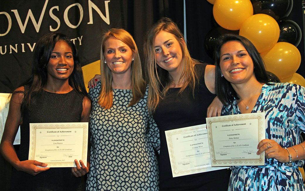 Four women holding certificates