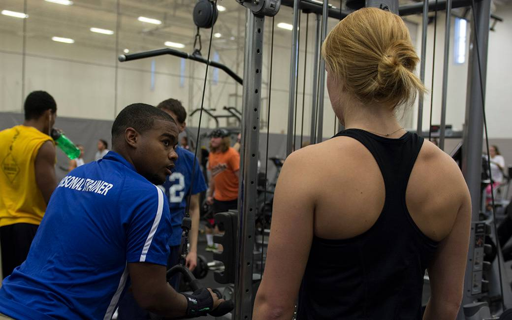 Towson Campus Rec Personal Trainer Works with a Client