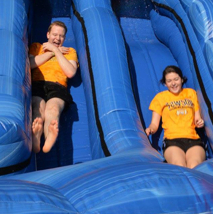 TU students sliding down an inflatible slide