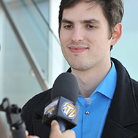 A TU employee being interviewed by media representatives
